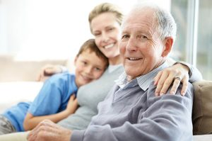 Elderly man with family smiling